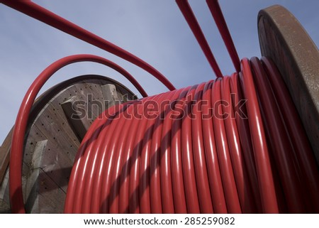 Wooden Coil of Red Electric Cable Outdoor