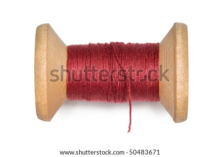 wooden coil with red threads isolated on white background - stock photo