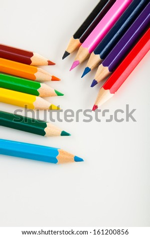 Wooden color pencils on white background