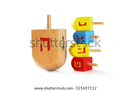 wooden colorful dreidels (spinning top) for hanukkah jewish holiday isolated on white  - stock photo