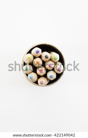 Wooden colorful pencils with sharpening shavings, on white background. - stock photo