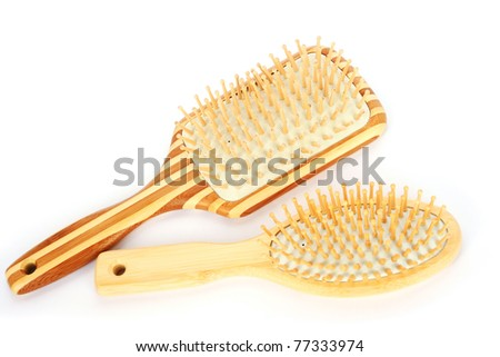 Wooden combs isolated on white background. - stock photo