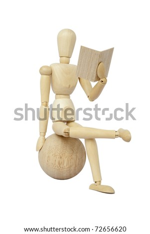 Wooden concept of mannequin in pose of reader