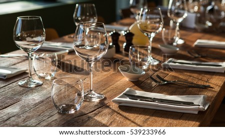 wooden contemporary table setting sunny day