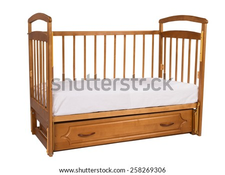 Wooden cot with mattress isolated on white background - stock photo