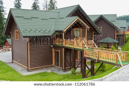 Wooden cottage in the resort Bukovel. Ukraine - stock photo
