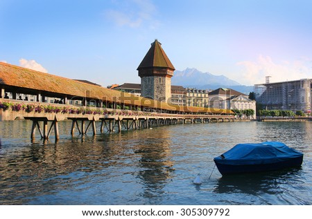 Wooden covered, Chapel Bridge located in Lucerne, Switzerland in early evening