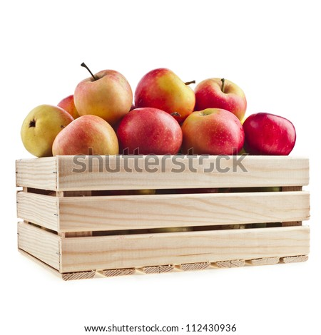 Wooden crate box full of fresh apples isolated on a white background - stock photo