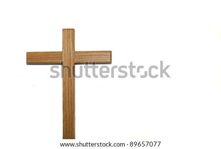 Wooden cross against white background - stock photo
