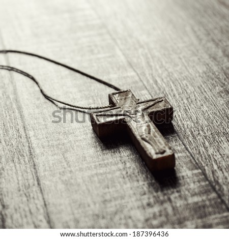 wooden cross on a wooden surface, close up - stock photo
