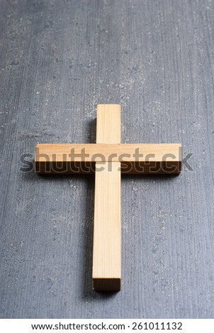 wooden cross on rusty black wood background - stock photo