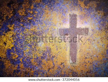 Wooden cross on rusty metal background with light effected, Christian concept - stock photo