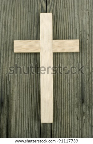 wooden cross on wood background - stock photo