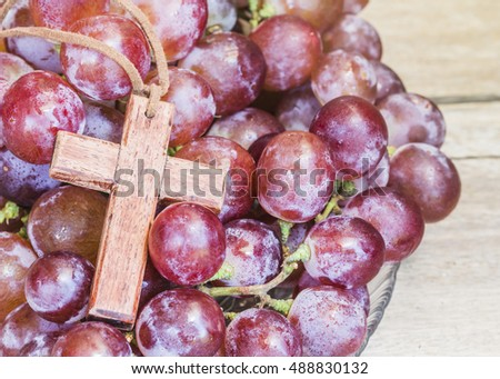 wooden cross with red grape on wooden background, christian concept background, Jesus is the true vine from bible verses John 15:1