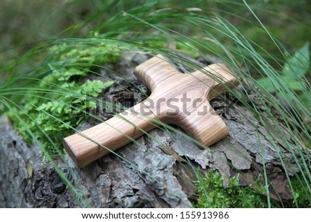 Wooden cross with tree on a green natural background - stock photo