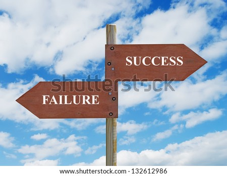 wooden crossroad sign on cloudy background with Success and Failure writing - stock photo
