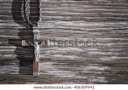 wooden crucifix pendant - stock photo