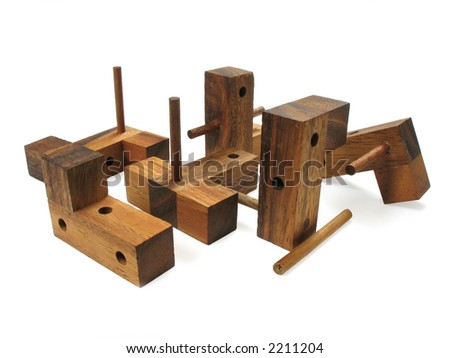 Wooden cube puzzle. Isolated on white background. Contains Clipping Path. - stock photo