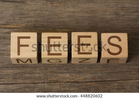 Wooden cubes with the word: Fees