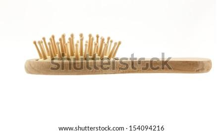Wooden cushion hair brush isolated on white background - stock photo