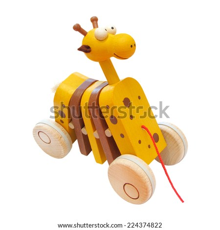 Wooden cute giraffe. Handmade clapping toy on wheels. - stock photo