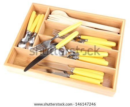 Wooden cutlery box with checked cutlery isolated on white - stock photo
