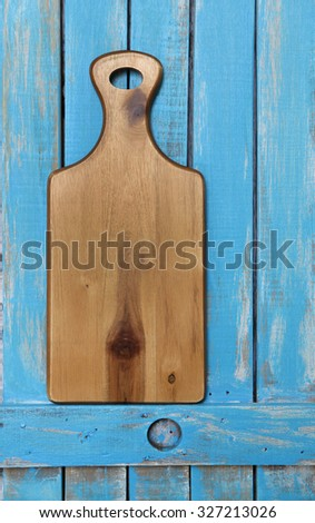 Wooden cutting board on Old wood background - stock photo
