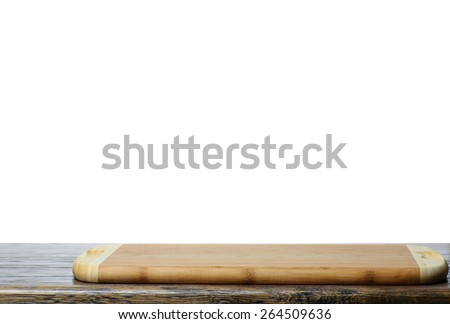 Wooden cutting board on the kitchen table with isolated backgrou
