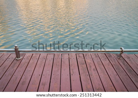 Wooden deck at the lake in Thailand