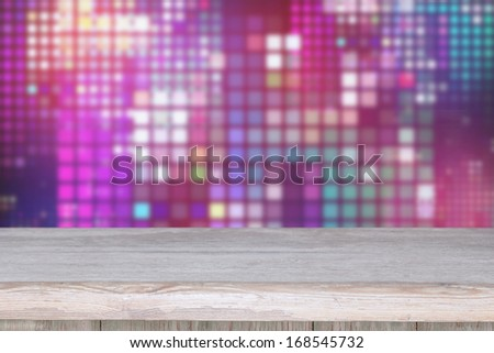 Wooden deck table on abstract background - stock photo