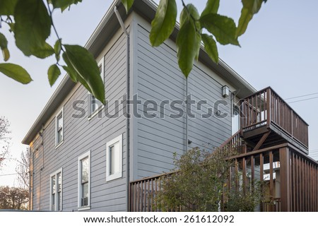 Wooden Deck with Terrace in Wooden House. Freshly stained backyard deck - stock photo