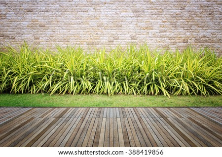 Wooden decking and plant with wall garden decorative - stock photo