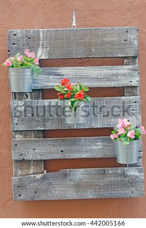 Wooden decoration for wall with small flower pots
