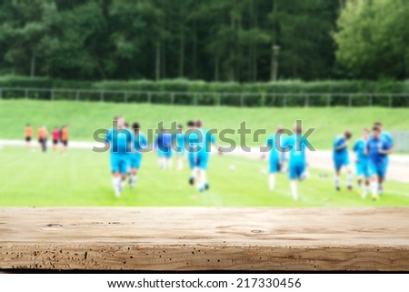 wooden desk and grass  - stock photo