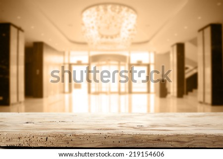 wooden desk and interior of hotel lobby place  - stock photo