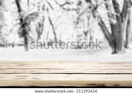 wooden desk and park of snow space  - stock photo