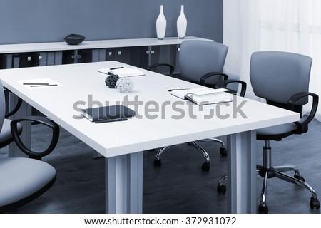 wooden desk in a modern office - stock photo