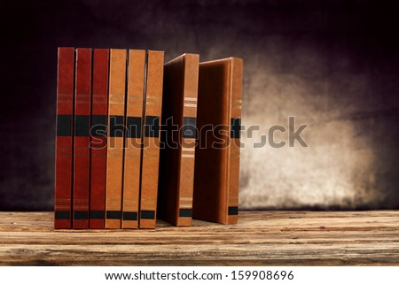wooden desk of books  - stock photo