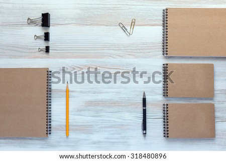 Wooden Desk with Business Items in Calm Classic Colors Mock Up Template of Stationary Supplies and Tools in Office Every Day Life Top View Directly from Above