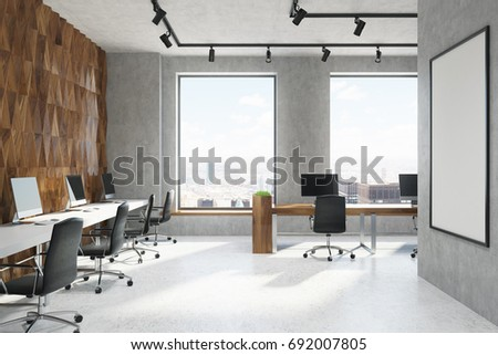 Wooden Diamond Pattern And Concrete Wall Office Room With Rows Of Computer  Tables With Black Monitors