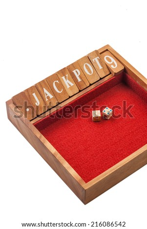 Wooden dice jackpot board game - stock photo