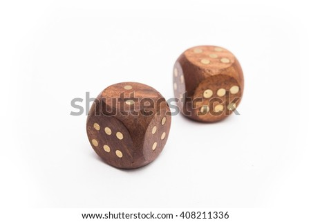 Wooden dices with metallic points