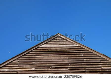 Wooden dilapidated A-frame set off against a deep azure blue sky