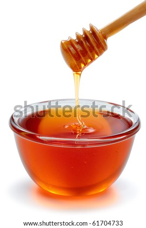 Wooden dipper with bowl of honey, isolated on the white background, clipping path included. - stock photo
