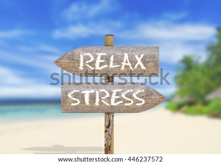 Wooden direction sign relax or stress - stock photo