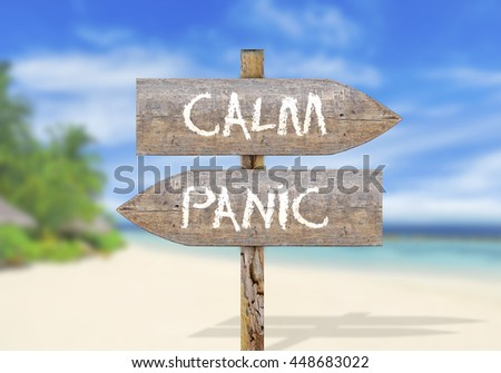 Wooden direction sign with calm and panic - stock photo