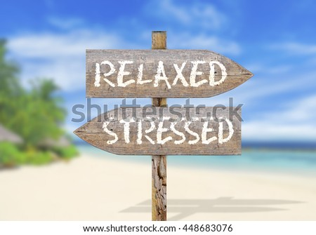 Wooden direction sign with relaxed stressed - stock photo