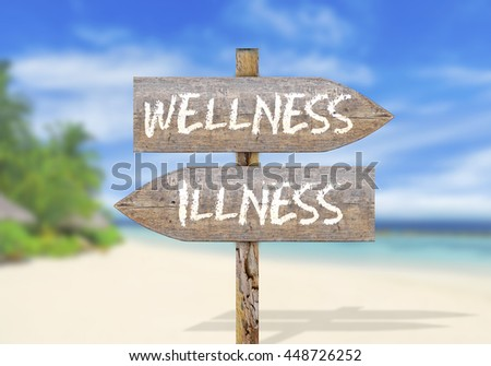 Wooden direction sign with wellness and illness - stock photo