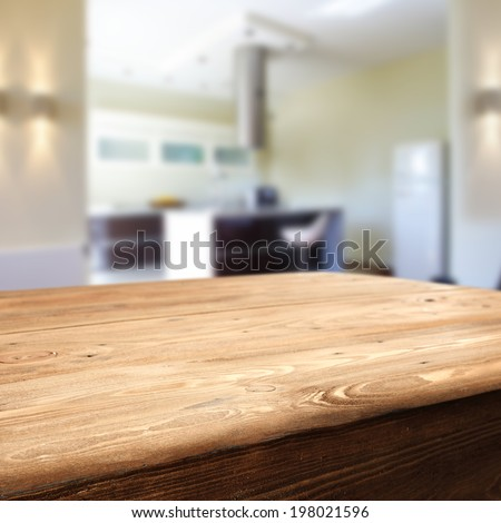 wooden dirty table and kitchen  - stock photo