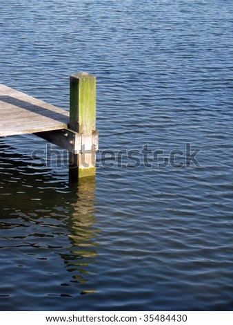 Wooden dock, lake in The Netherlands - stock photo